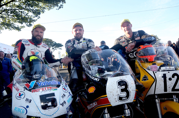 Bruce Anstey, Michael Dunlop and Ryan Farquhar in the winners' enclosure following the 2015 Formula 1 Classic TT - the precursor to the Superbike Classic TT.