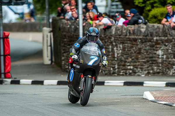 Robert Wilson riding the Team Sarolea Racing machine through St Ninian's crossroads in the 2015 Isle of Man TT.