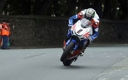 John McGuinness TT 2011 Superbike out of seat St Ninians - click to enlarge