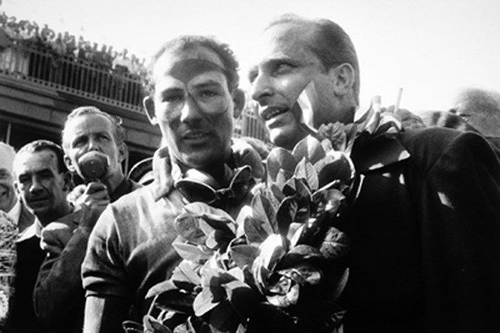 Stirling Moss and Juan Manuel Fangio 1955 British GP  - click to enlarge