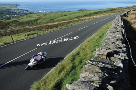 John McGuinness Climbs the Mountain TT 2012 - click to enlarge