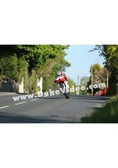 Michael Dunlop wheelies through Ballagarey, TT 2013
