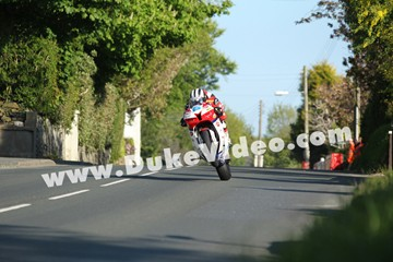 Michael Dunlop wheelies through Ballagarey, TT 2013 - click to enlarge