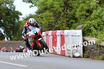 TT 2014 Michael Dunlop wheelies over bridge - click to enlarge