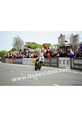 TT 2014 Michael Dunlop racing through Grandstand