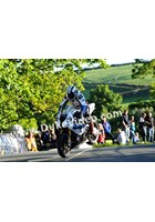 Michael Dunlop jumps Ballaugh Bridge.