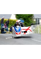 TT 2014 Conrad Harrison and Mike Aylott jumping at Ballaugh