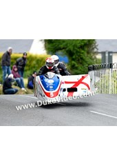 TT 2014 Conrad Harrison and Mike Aylott jumping at Ballaugh